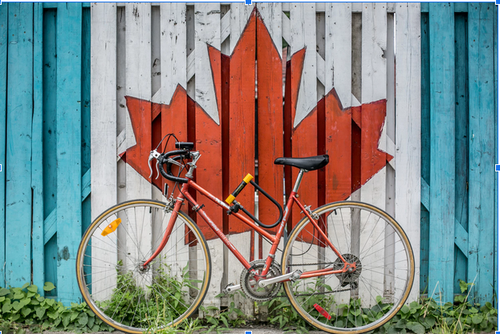 Red Bicycle against a wall, Ontario Canada